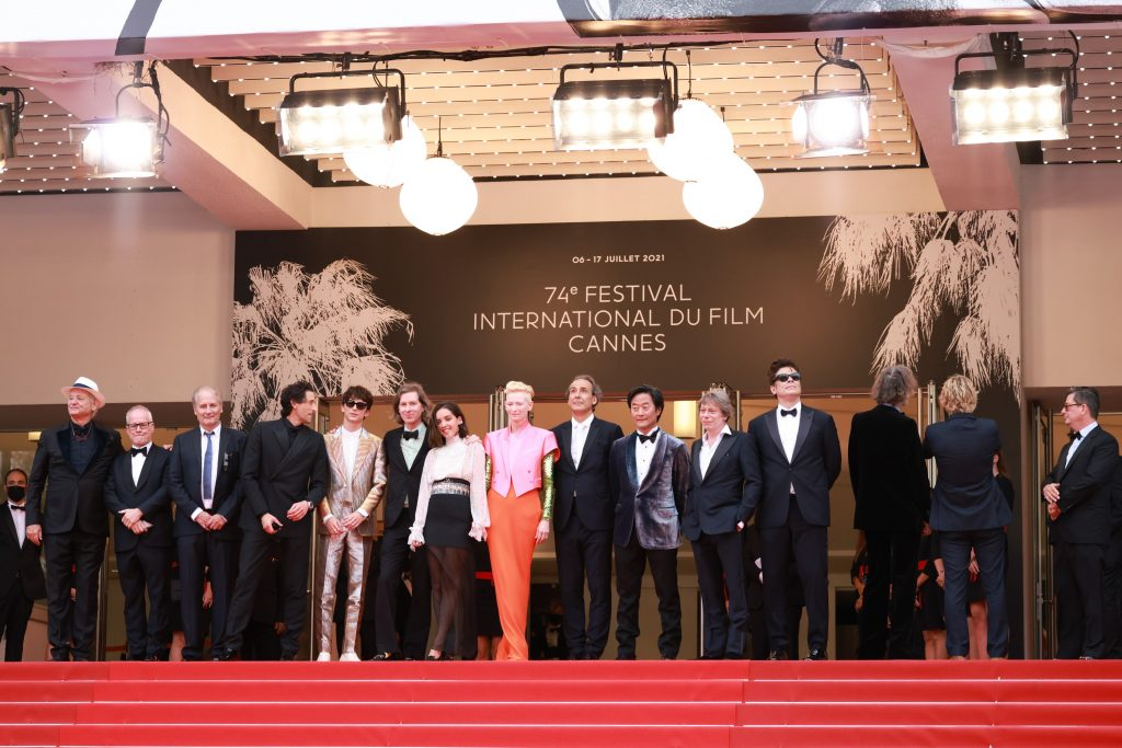 """""""The French Dispatch"""" Red Carpet - The 74th Annual Cannes Film Festival CANNES, FRANCE - JULY 12: [ Wes Anderson, Mathieu Amalric, Bill Murray, Tilda Swinton, Timothée Chalamet, Adrien Brody, Lyna Khoudri, Hippolyte Girardot,  Owen Wilson, Alexandre Desplat, Benicio del Toro, ] attends the """"The French Dispatch"""" Screening during the 74th annual Cannes Film Festival on July 12, 2021 in Cannes, France. (Photo by Serge Arnal For Disney Studios) *** Cannes***"""